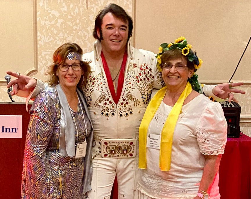 Convention chair Carolyn and co chair and GCO President Marlene both got scarves from Elvis!