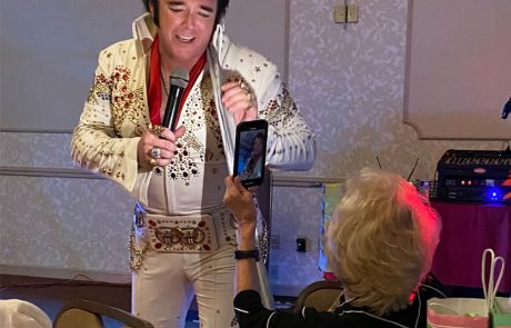 Mary Lou captures Elvis in action at the board dinner.